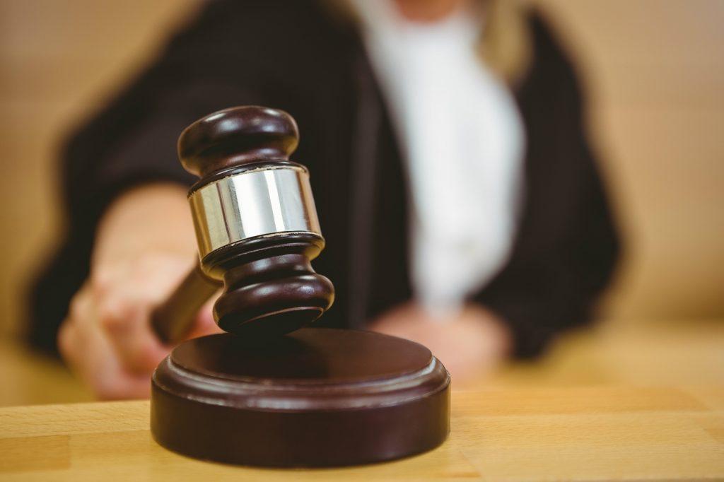 Judge pounding gavel